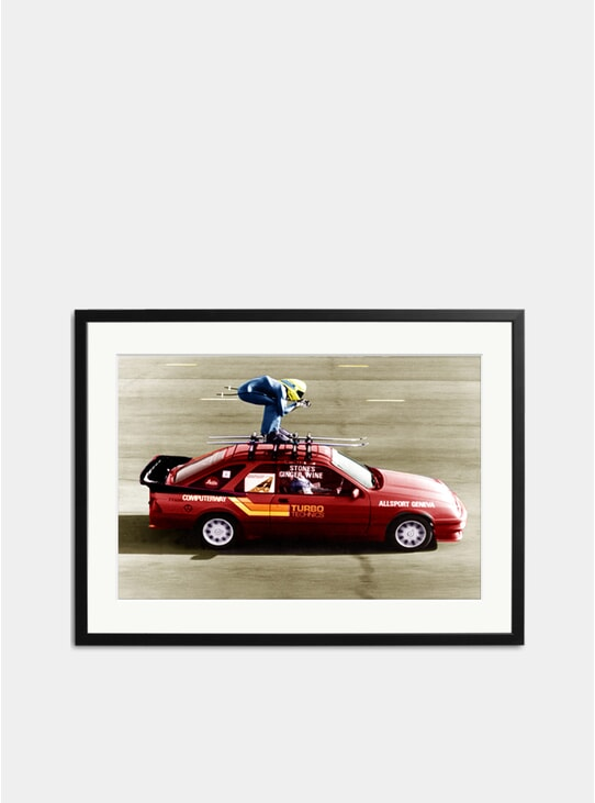 Stunt: A Skier On The Roof Rack Of A Car Photograph