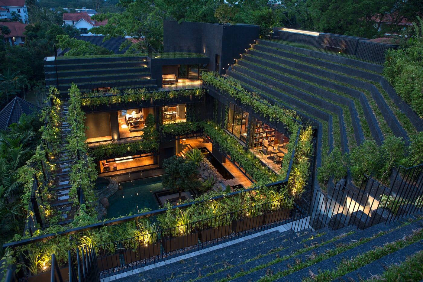 22.-View-from-roof-garden-depicts-how-e-house-steps-&-falls-with-e-terrain,-forming-an-amphitheatre-at-e-heart-of-e-plan.