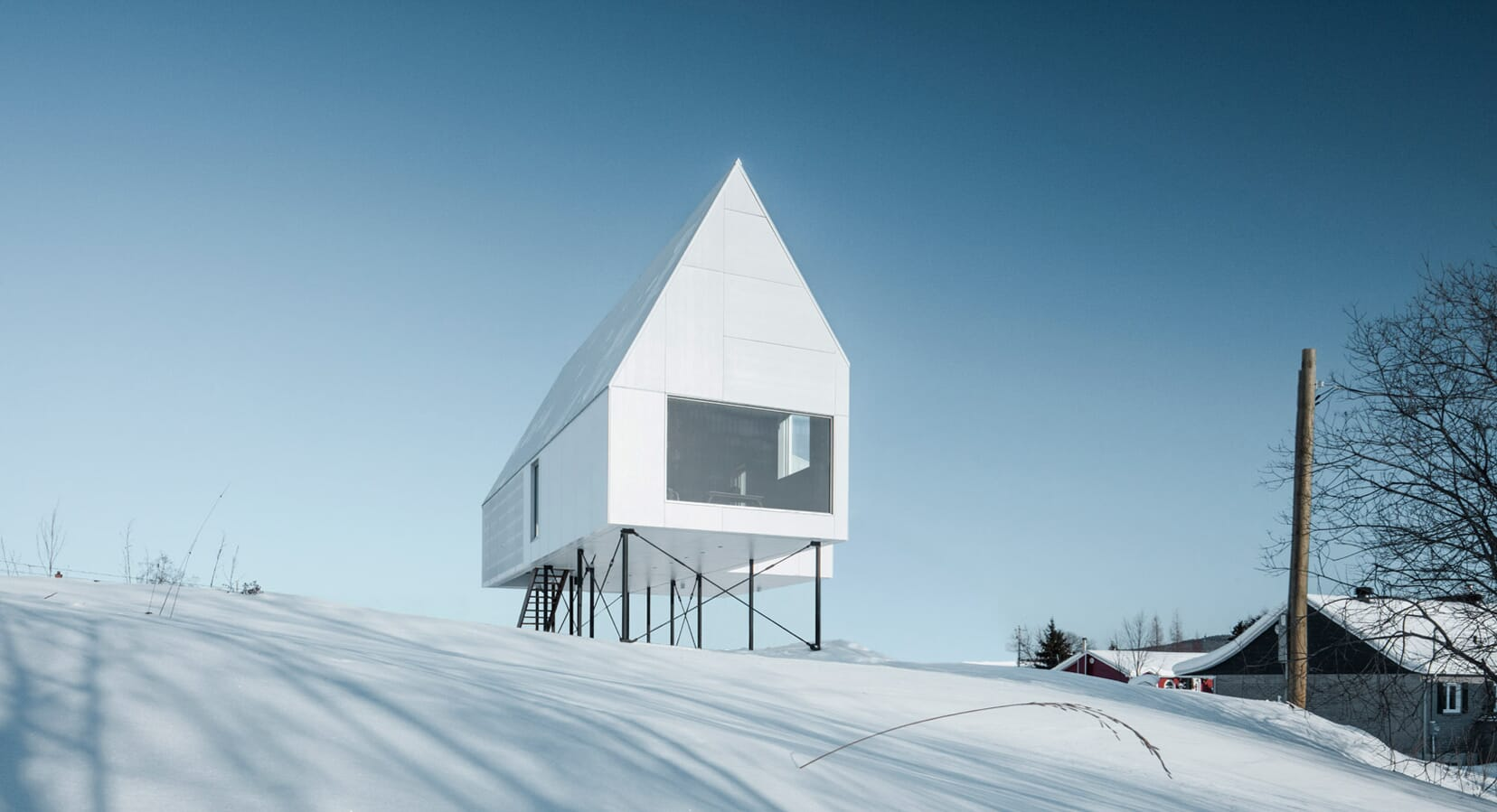 Delordinaire Raises the High House Above Snowy Quebec Countryside