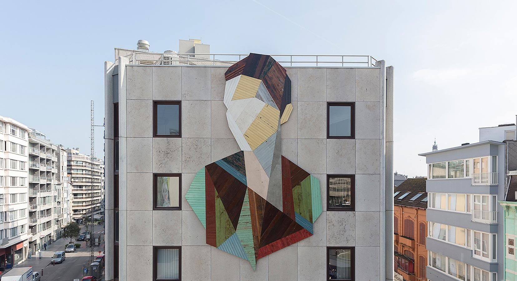 Strook Constructs Giant Geometric Portraits From Reclaimed Wood