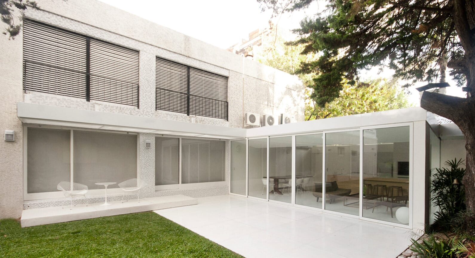 Effortless Serenity: Take A Look Inside This Pristine White Garden Extension
