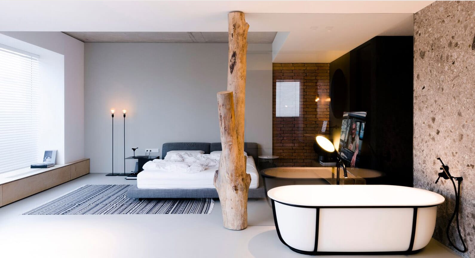 This Moldovan Penthouse Features A Tree Trunk In Bedroom