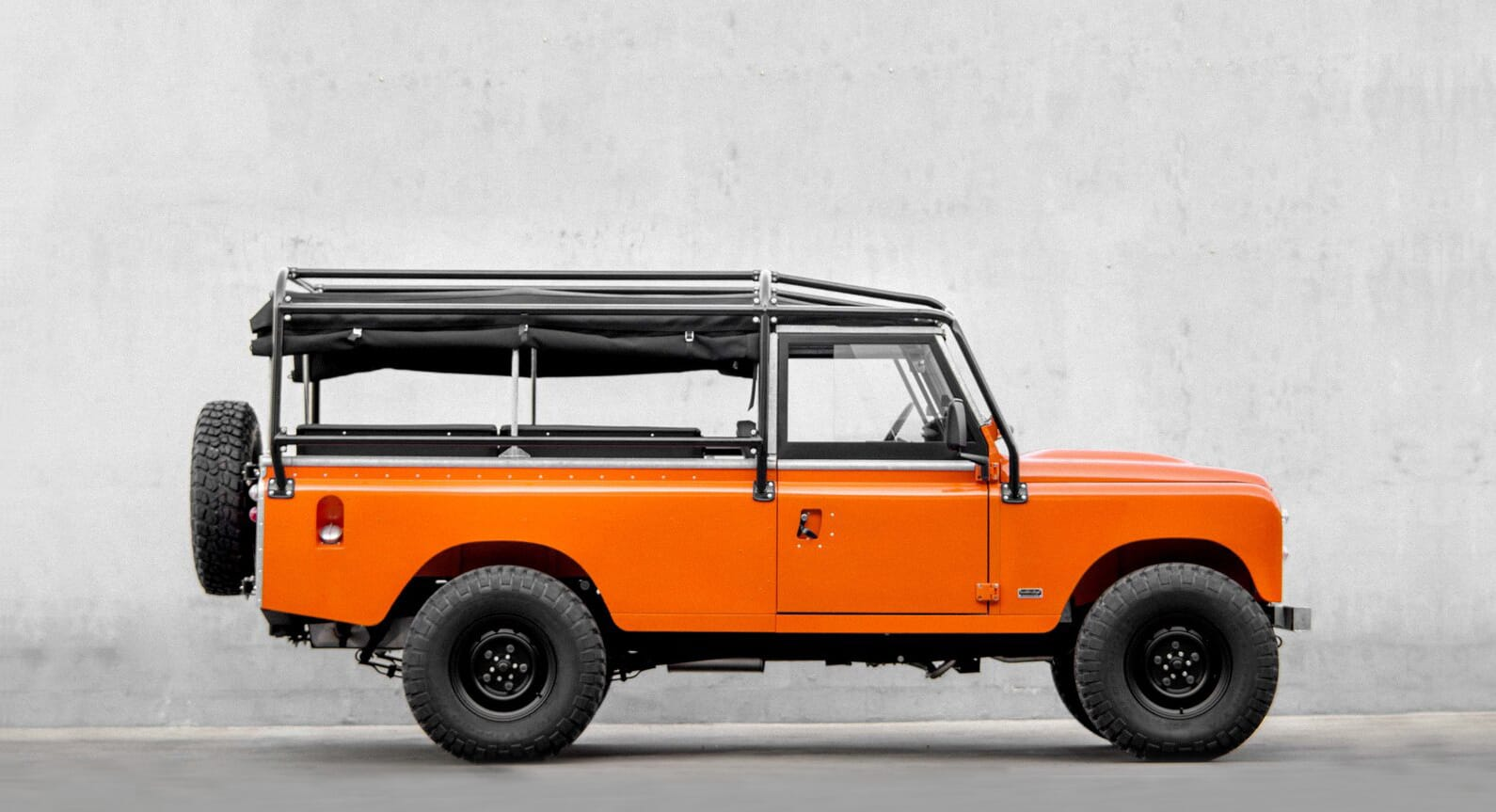 A First Look At The Tangerine Orange Land Rover by Cool & Vintage