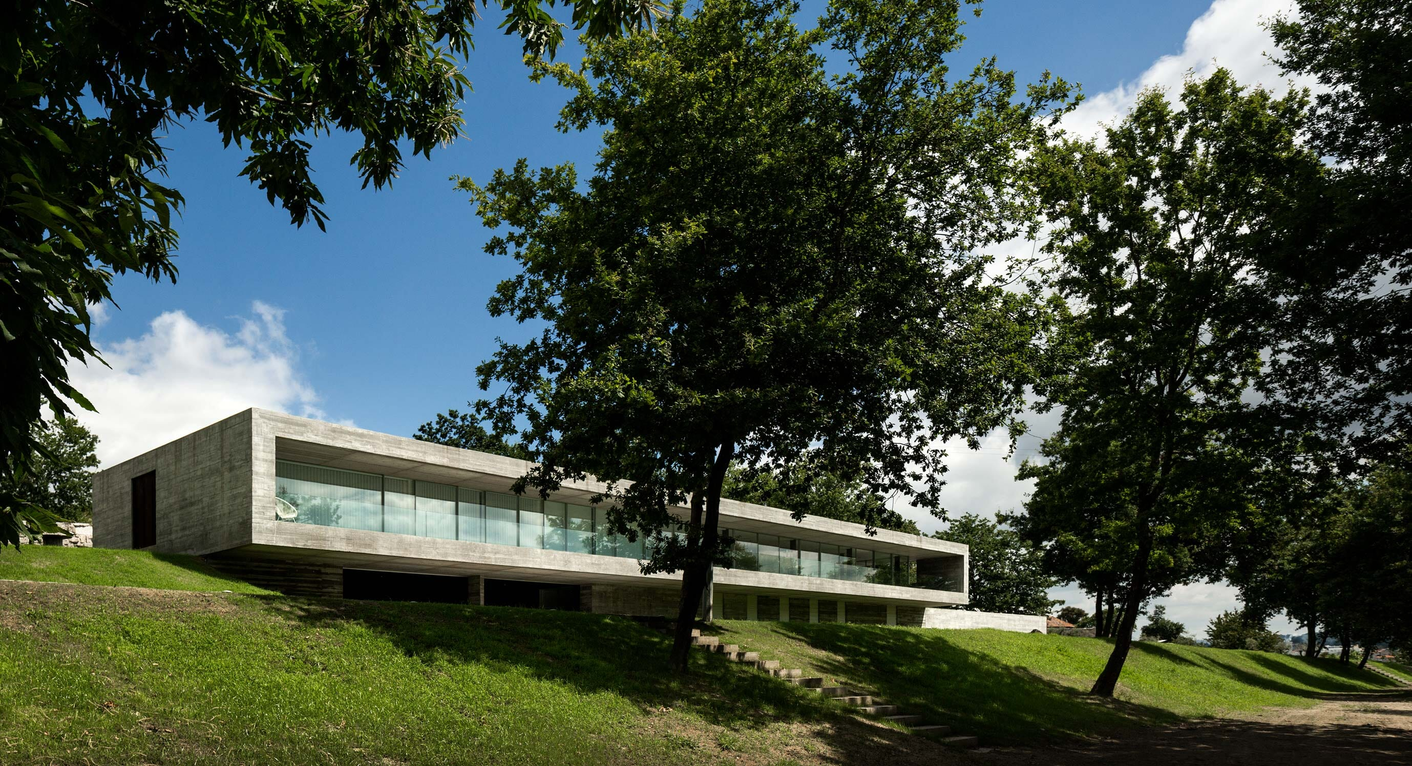 Sambade House Draws Parallels Between Concrete And Countryside