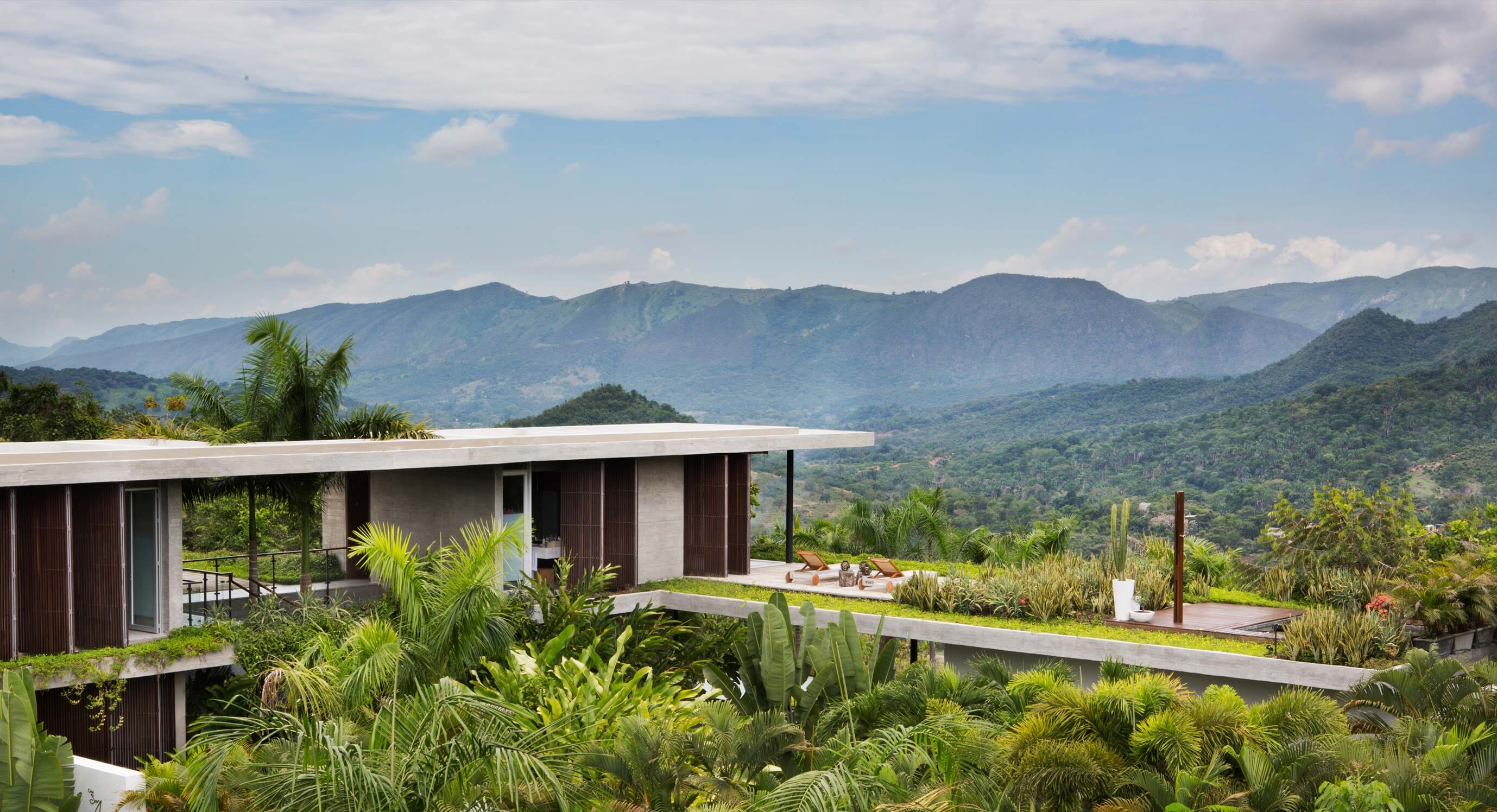 Nilo Houses Are Entwined With Their Exotic Surroundings